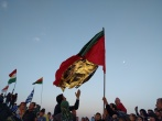 A Kurdish flag made partially from one of the ubiquitous survival blankets of the refugee journey